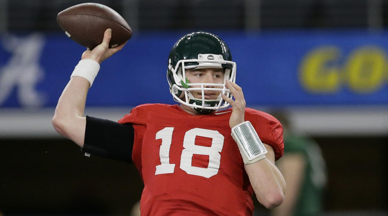 Michigan State quarterback Connor Cook passes during team practice for the NCAA Cotton Bowl college football game against the Alabama Monday, Dec. 28, 2015, in Dallas. Cook says his shoulder is feeling great after a late-season injury. (AP Photo/LM Otero)