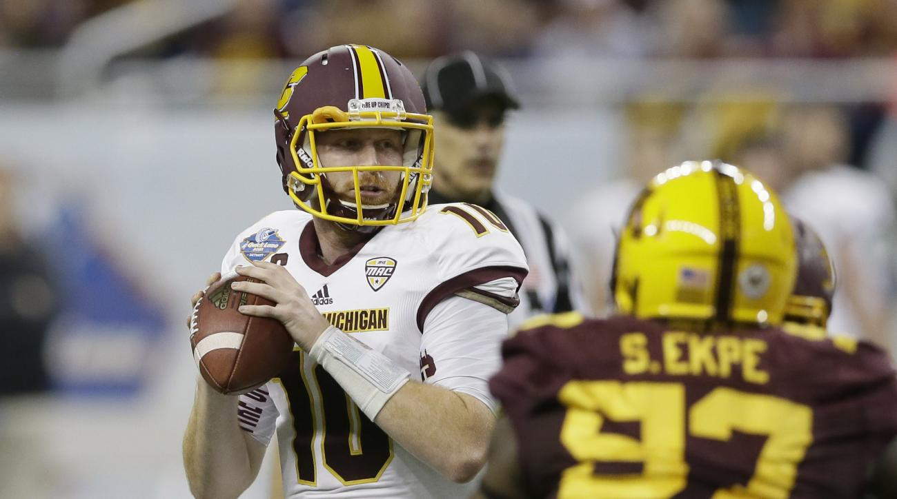 Central Michigan quarterback Cooper Rush looks downfield during the first half of the Quick Lane Bowl NCAA college football game against Minnesota, Monday, Dec. 28, 2015, in Detroit. (AP Photo/Carlos Osorio)