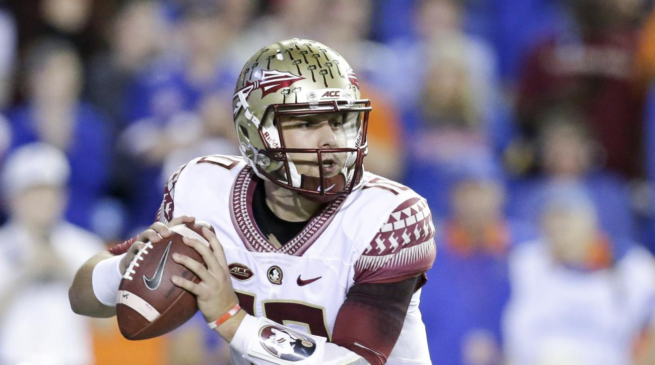 FILE - In this Nov. 28, 2015 file photo, Florida State quarterback Sean Maguire looks for a receiver against Florida during the first half of an NCAA college football game, in Gainesville, Fla. Maguire, attempting to solidify his hold on Florida State's s