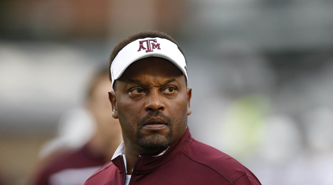 FILE - In this Saturday, Oct. 24, 2015 file photo, Texas A&M head coach Kevin Sumlin looks at the score board prior to their NCAA college football game against Mississippi in Oxford, Miss. Texas A&M coach Kevin Sumlin goes into the Music City Bowl down to