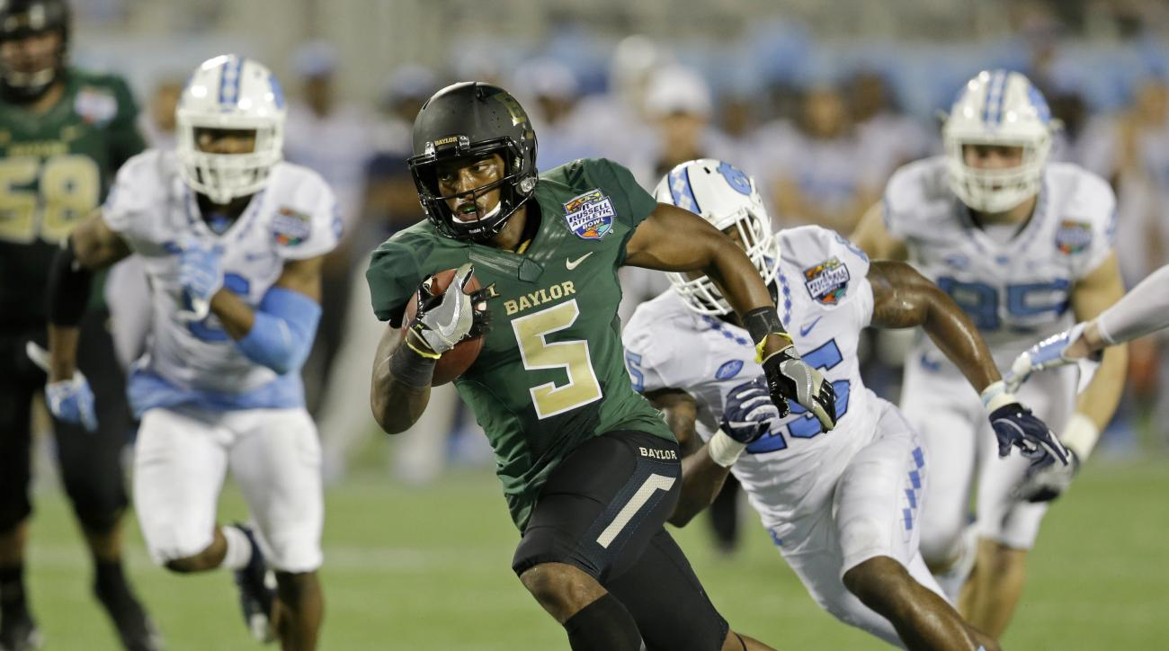 Baylor running back Johnny Jefferson (5) runs past North Carolina cornerback M.J. Stewart (6) and safety Donnie Miles, right, for a 27-yard touchdown run during the first half of the Russell Athletic Bowl NCAA college football game, Tuesday, Dec. 29, 2015
