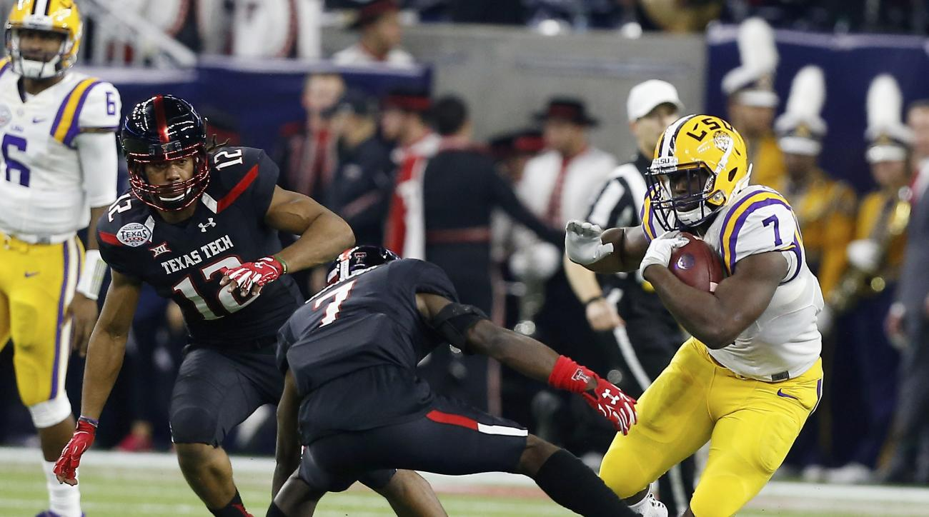 LSU running back Leonard Fournette (7) avoids Texas Tech defensive back Jah'Shawn Johnson (7) and defensive lineman Zach Barnes (12) during the first half of the Texas Bowl NCAA college football game Tuesday, Dec. 29, 2015, in Houston. (AP Photo/Bob Levey