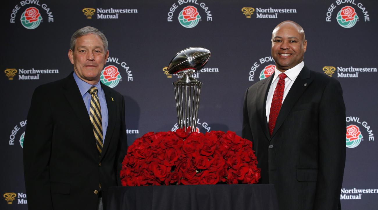 Stanford head coach David Shaw, right, and Iowa head coach Kirk Ferentz pose for photos during a news conference for the Rose Bowl NCAA college football game, Wednesday, Dec. 30, 2015, in Los Angeles. The two teams are scheduled to play on New Year's Day.