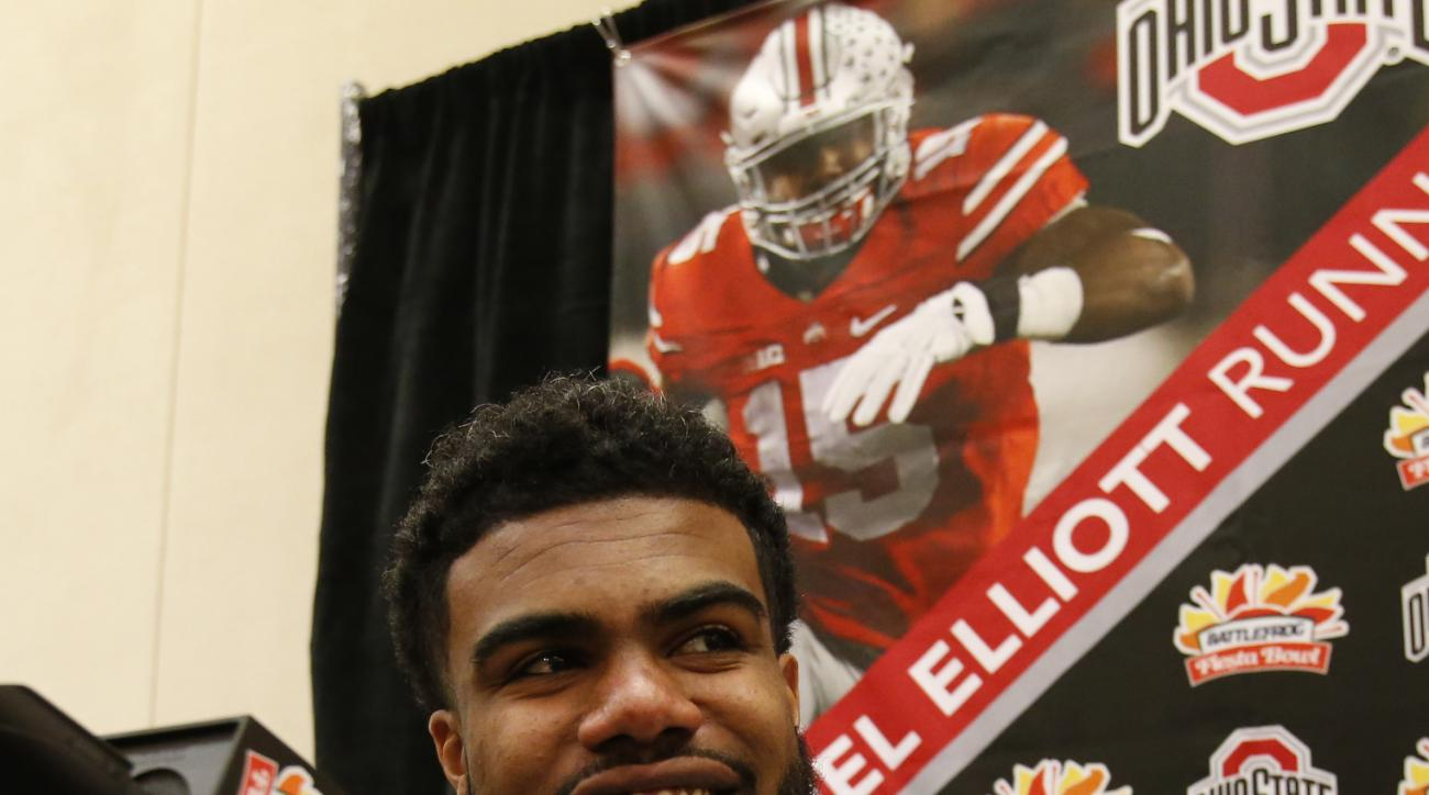Ohio State running back Ezekiel Elliott talks to the media during media day for the Fiesta Bowl NCAA college football game, Wednesday, Dec. 30, 2015, in Scottsdale, Ariz. Ohio State plays Notre Dame on New Year's Day. (AP Photo/Rick Scuteri)