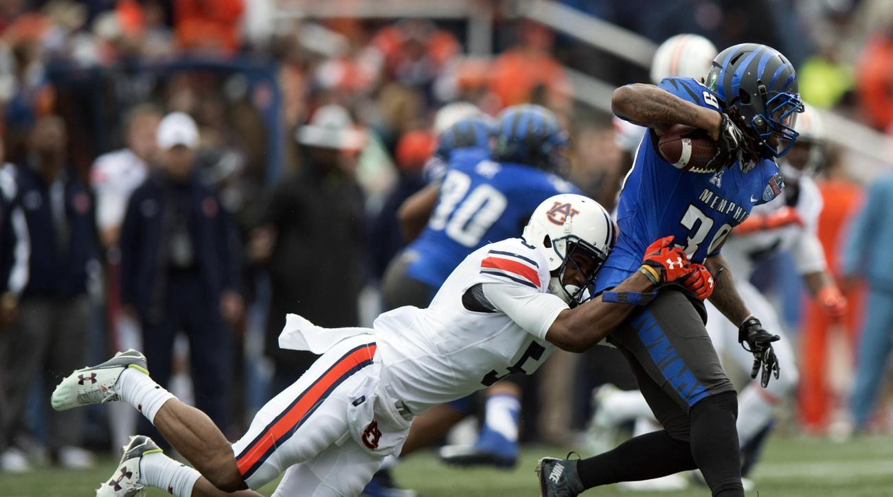 Memphis defensive back Reggis Ball (39) returns an interception as Auburn wide receiver Ricardo Louis (5) tackles him during the Birmingham Bowl NCAA college football game, Wednesday, Dec. 30, 2015, in Birmingham, Ala. (Albert Cesare/The Montgomery Advert