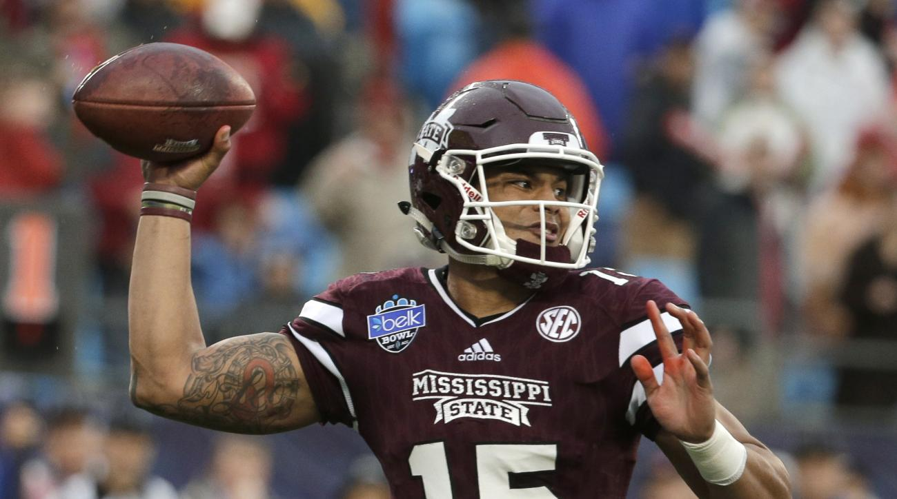 Mississippi State's Dak Prescott (15) looks to pass against North Carolina State during the first half of the Belk Bowl NCAA college football game in Charlotte, N.C., Wednesday, Dec. 30, 2015. (AP Photo/Chuck Burton)