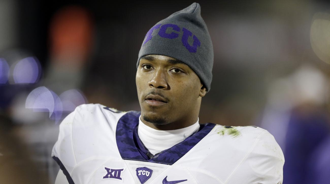 FILE - In this Oct. 17, 2015, file photo, TCU quarterback Trevone Boykin stands on the sidelines during the second half of an NCAA college football game against Iowa State in Ames, Iowa.  Boykin has been charged with felony assault of a police officer.  S