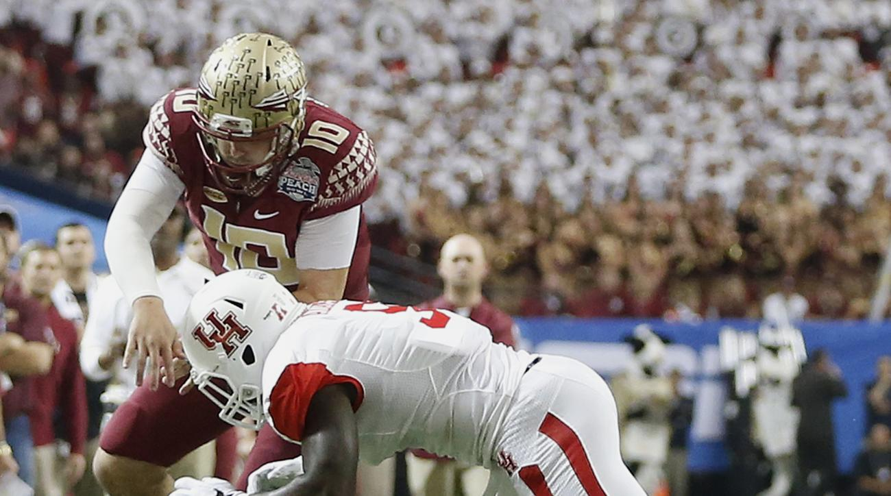 Houston linebacker Matthew Adams (9) hits Florida State quarterback Sean Maguire (10) during the first half of the Peach Bowl NCAA college football game, Thursday, Dec. 31, 2015, in Atlanta. Maguire left the field after the hit. (AP Photo/John Bazemore)