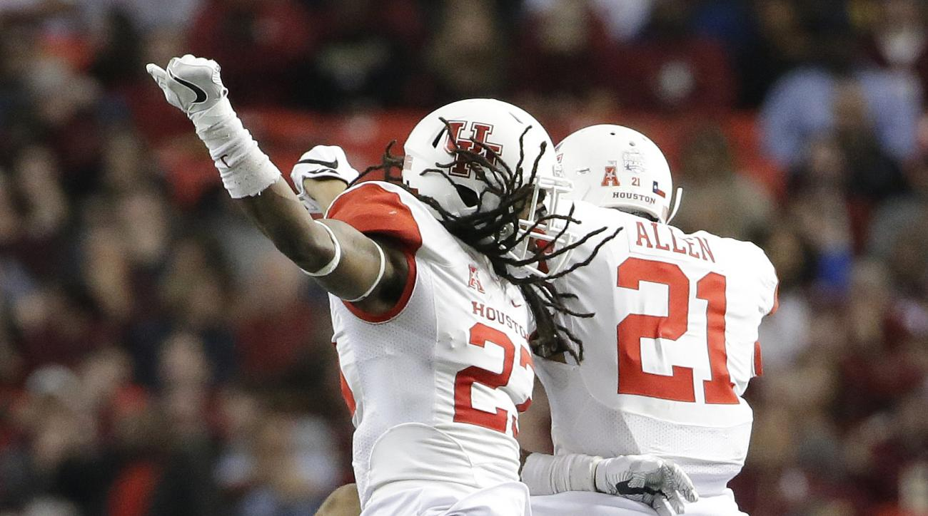 Houston safety Trevon Stewart (23) celebrates his interception with Houston linebacker Ralph Harvey Jr. (21) during the second half of the Peach Bowl NCAA college football game against Florida State, Thursday, Dec. 31, 2015, in Atlanta. (AP Photo/David Go