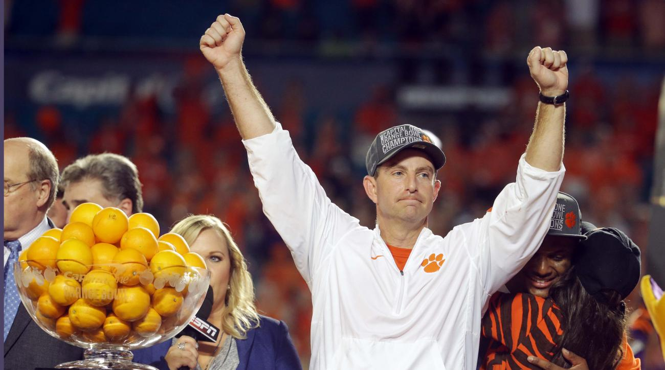 Clemson head coach Dabo Swinney raises his arms after winning the Orange Bowl NCAA college football semifinal playoff game against Oklahoma, Thursday, Dec. 31, 2015, in Miami Gardens, Fla. Clemson defeated Oklahoma 37-17 to advance to the championship gam