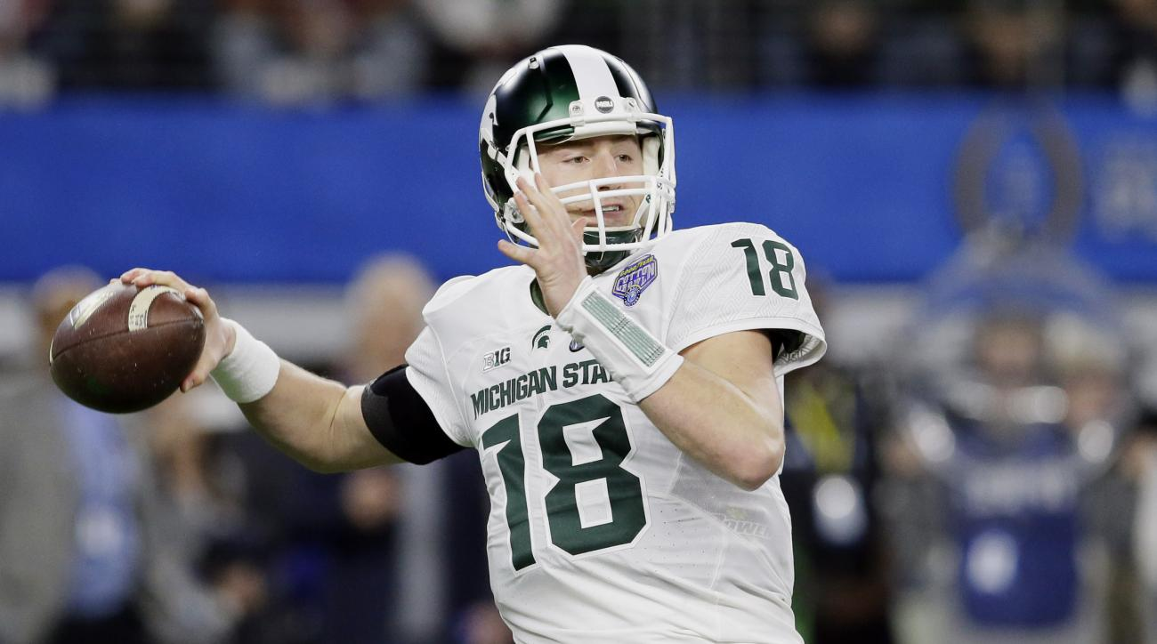Michigan State quarterback Connor Cook passes the ball during the first half of the Cotton Bowl NCAA college football semifinal playoff game against Alabama, Thursday, Dec. 31, 2015, in Arlington, Texas. (AP Photo/LM Otero)