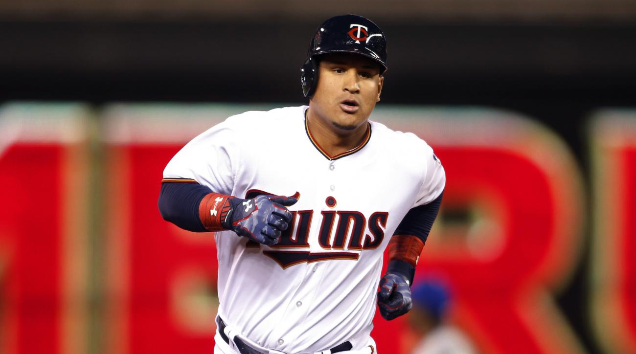 Minnesota Twins' Oswaldo Arcia runs the bases after hitting a two run home run against the Kansas City Royals in the fourt inning of a baseball game Wednesday, April 15, 2015, in Minneapolis. (AP Photo/Bruce Kluckhohn)