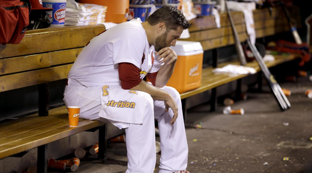 St. Louis Cardinals starting pitcher Lance Lynn sits in the dugout after working during the fourth inning of a baseball game against the Milwaukee Brewers Wednesday, April 15, 2015, in St. Louis. (AP Photo/Jeff Roberson)