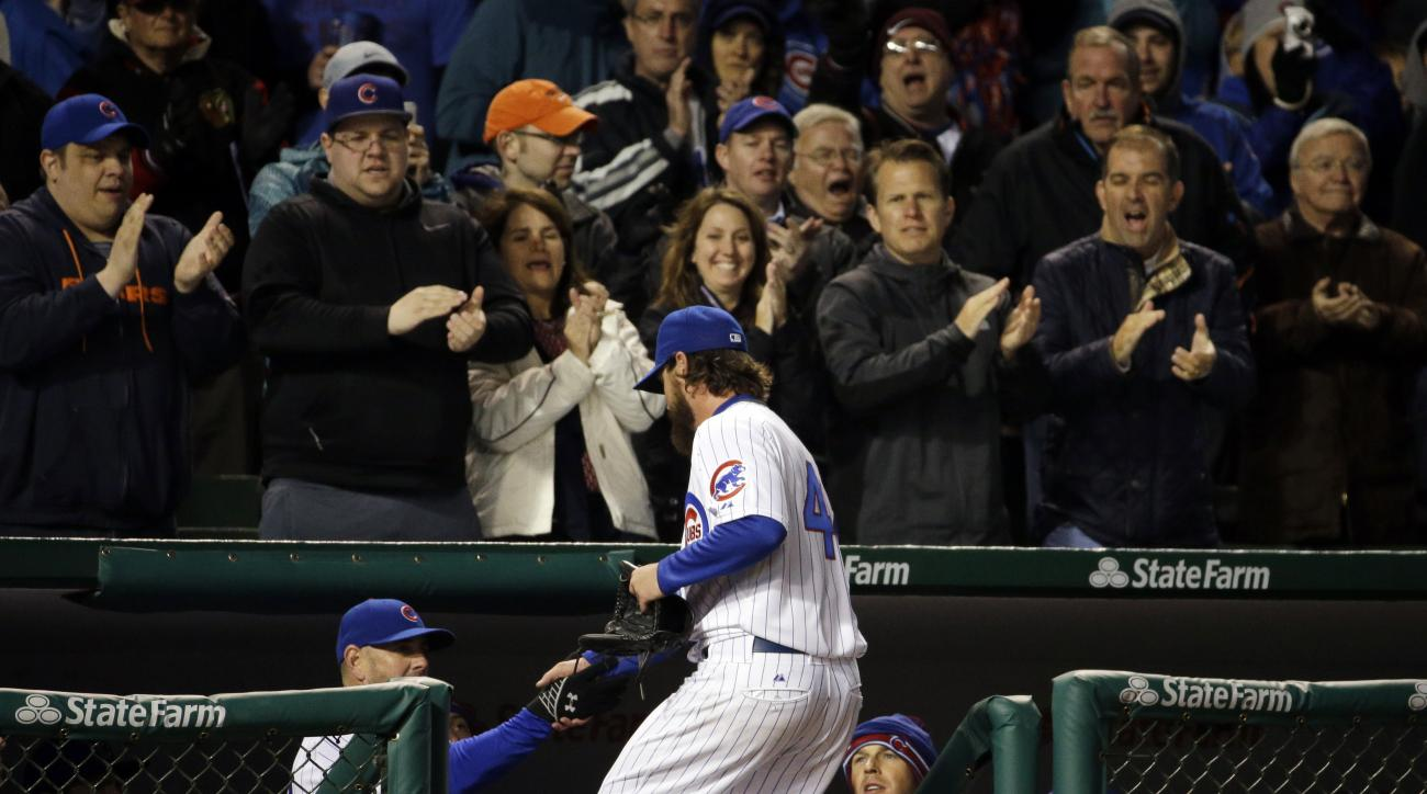 Chicago Cubs starter Travis Wood celebrates with teammates after he left the field during the eighth inning of a baseball game against the Cincinnati Reds in Chicago, Wednesday, April 15, 2015. (AP Photo/Nam Y. Huh)