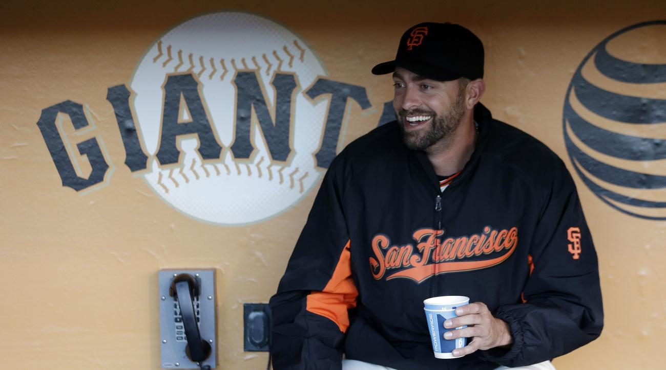 San Francisco Giants reliever Jeremy Affeldt smiles as he watches ceremonies before the Giants' baseball game against the Colorado Rockies on Wednesday, April 15, 2015, in San Francisco. (AP Photo/Marcio Jose Sanchez)