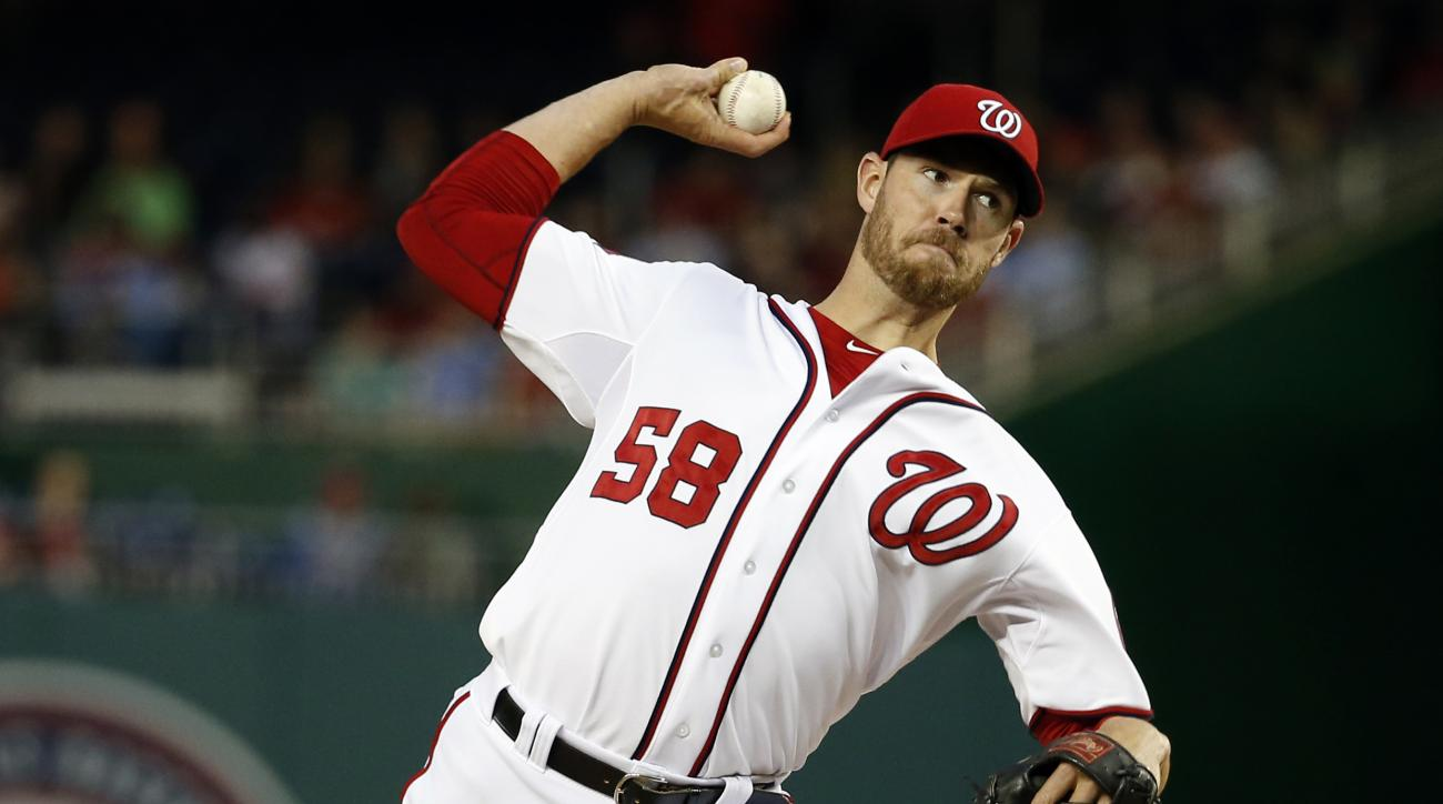 Washington Nationals starting pitcher Doug Fister throws during the third inning of a baseball game against the Philadelphia Phillies at Nationals Park, Thursday, April 16, 2015, in Washington. (AP Photo/Alex Brandon)