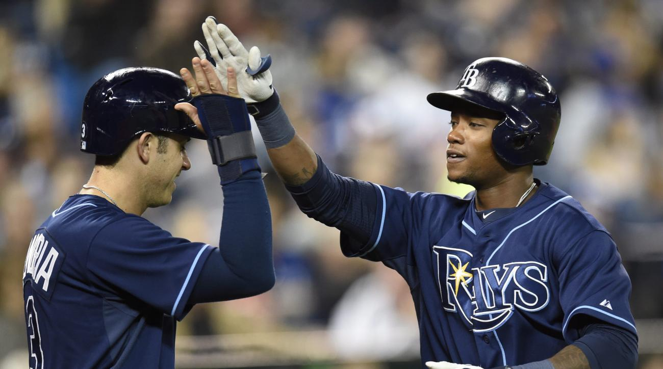 Tampa Bay Rays' Evan Longoria, left, and Tim Beckham celebrate after scoring on Beckham's home run against the Toronto Blue Jays during the sixth inning of a baseball game, Thursday, April 16, 2015 in Toronto. (Frank Gunn/The Canadian Press via AP)  MANDA