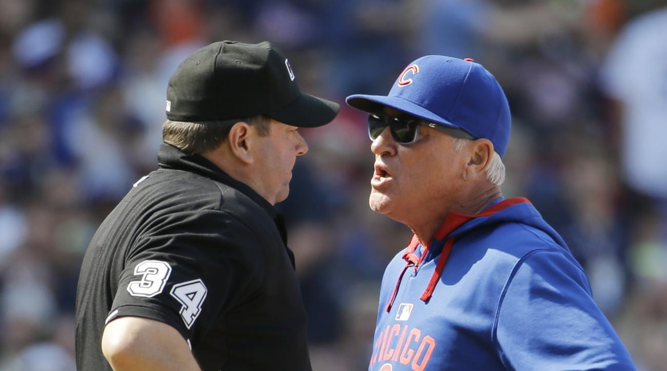 Chicago Cubs manager Joe Maddon, right, argues with home plate umpire Sam Holbrook during the seventh inning of a baseball game against the San Diego Padres in Chicago, Friday, April 17, 2015. (AP Photo/Nam Y. Huh)