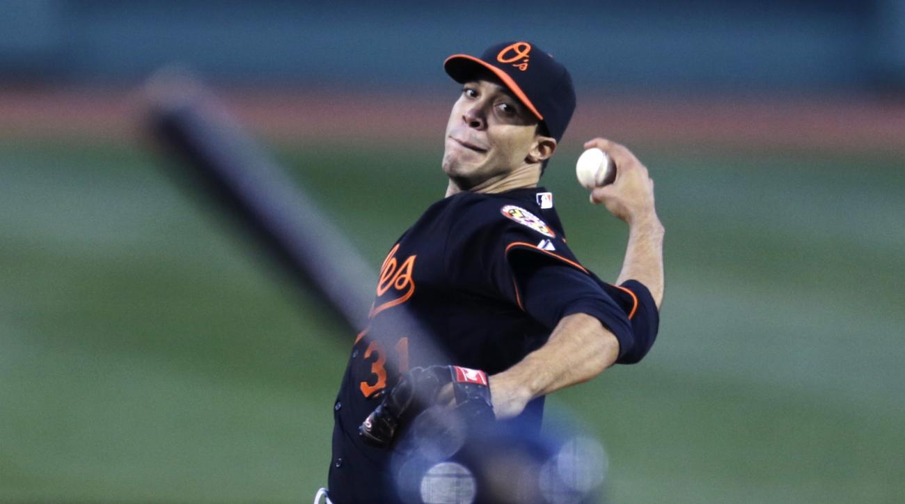 Baltimore Orioles starting pitcher Ubaldo Jimenez delivers against the Boston Red Sox during the first inning of a baseball game at Fenway Park in Boston, Friday, April 17, 2015. (AP Photo/Charles Krupa)