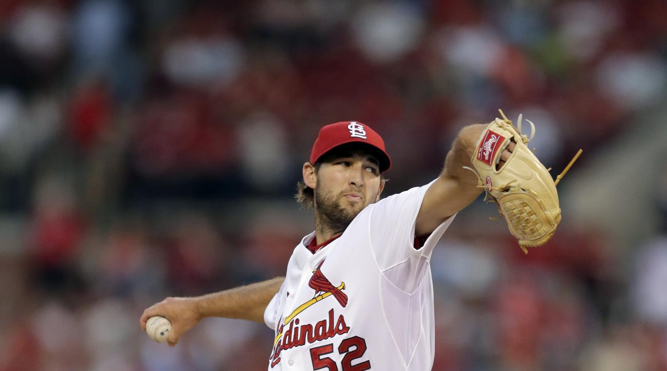 St. Louis Cardinals starting pitcher Michael Wacha throws during the first inning of a baseball game against the Cincinnati Reds Friday, April 17, 2015, in St. Louis. (AP Photo/Jeff Roberson)