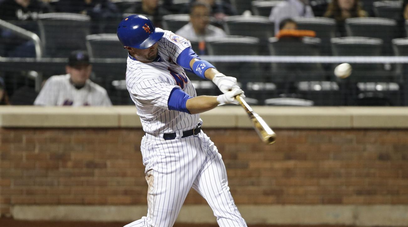 New York Mets' Michael Cuddyer hits a double during the eighth inning of a baseball game against the Miami Marlins on Friday, April 17, 2015, in New York. (AP Photo/Frank Franklin II)
