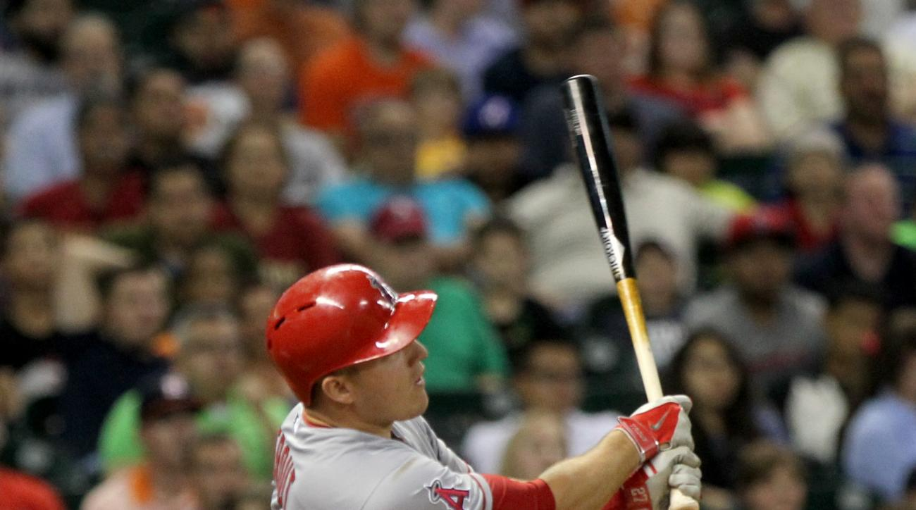 Los Angeles Angels Mike Trout hits a home run in the sixth inning against the Houston Astros during a baseball game Friday, April 17, 2015, in Houston. (Gary Coronado/Houston Chronicle via AP)