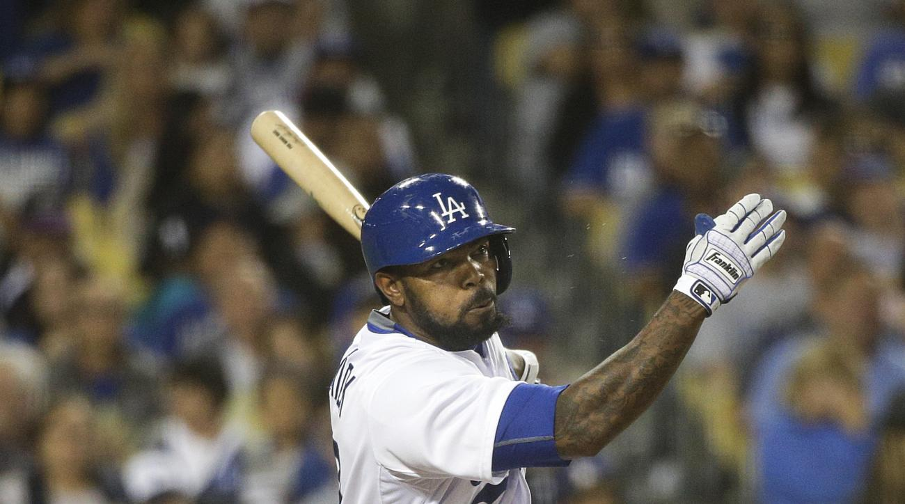 Los Angeles Dodgers' Howie Kendrick hits an RBI double during the fifth inning of a baseball game against the Colorado Rockies, Friday, April 17, 2015, in Los Angeles. (AP Photo/Jae C. Hong)