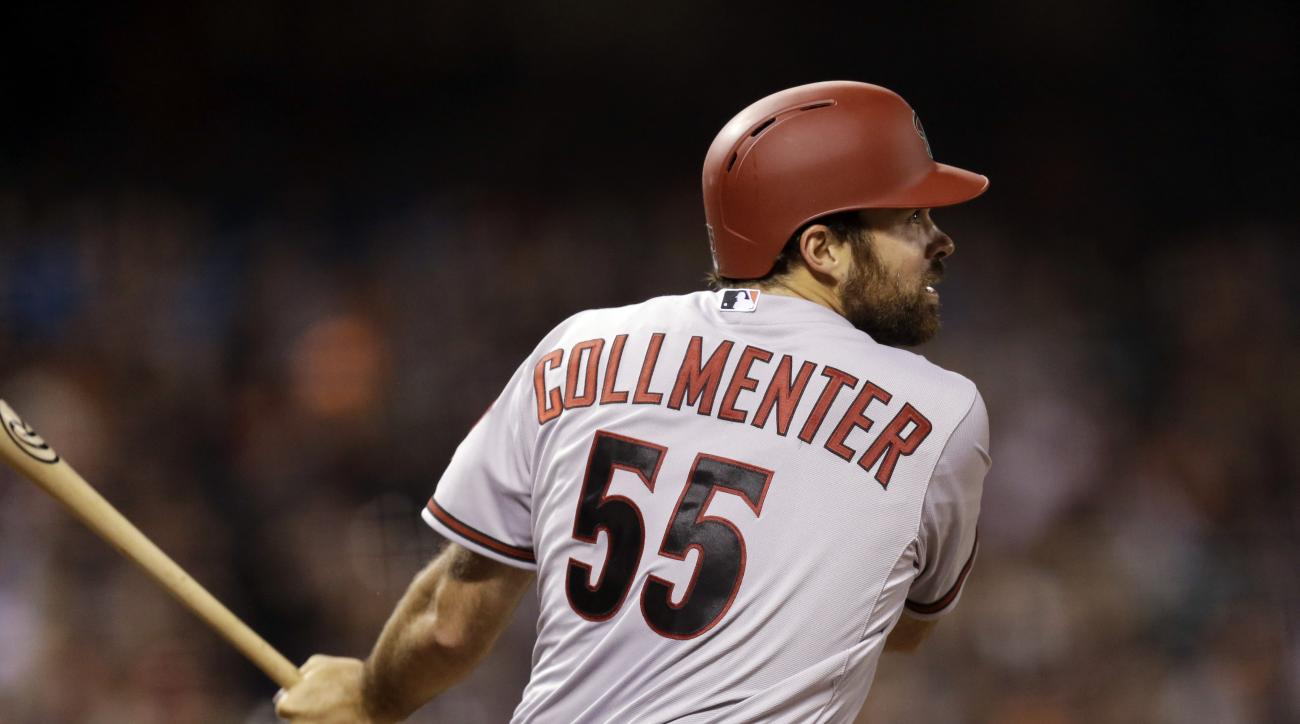 Arizona Diamondbacks' Josh Collmenter swings for an RBI double off San Francisco Giants' Ryan Vogelsong in the seventh inning of a baseball game Friday, April 17, 2015, in San Francisco. (AP Photo/Ben Margot)