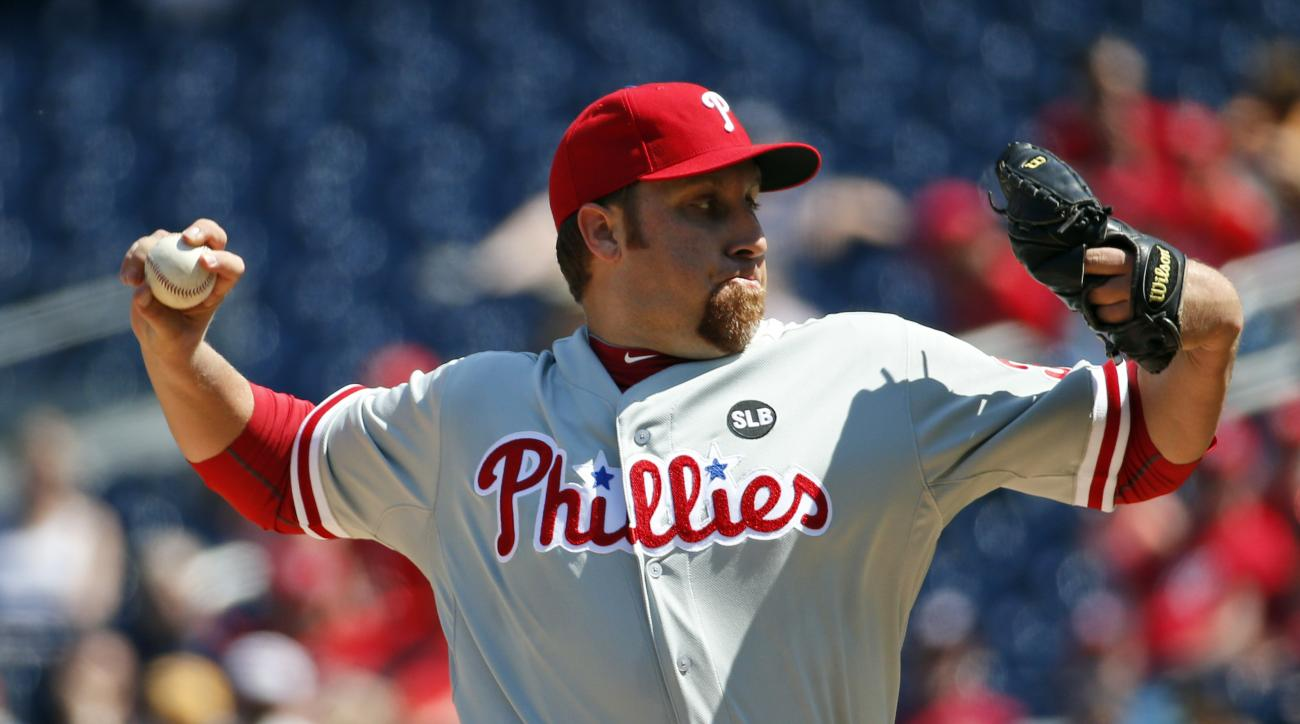 Philadelphia Phillies starting pitcher Aaron Harang throws during the third inning of a baseball game against the Washington Nationals at Nationals Park, Saturday, April 18, 2015, in Washington. (AP Photo/Alex Brandon)