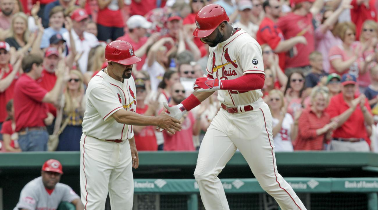 St. Louis Cardinals' Jason Heyward celebrates with third base coach Jose Oquendo after hitting a solo home run in the third inning of a baseball game against the Cincinnati Reds, Saturday, April 18, 2015, in St. Louis. (AP Photo/Tom Gannam)
