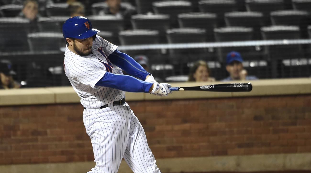 New York Mets' Travis d'Arnaud hits a solo home run off of Miami Marlins starting pitcher Mat Latos in the third inning of a baseball game at Citi Field on Saturday, April 18, 2015, in New York. (AP Photo/Kathy Kmonicek)