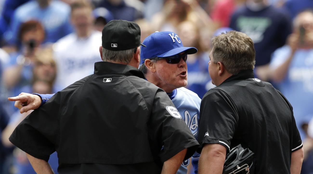 Kansas City Royals manager Ned Yost, back, argues with umpires Greg Gibson, right, and Jim Joyce, left, during the first inning of a baseball game against the Oakland Athletics at Kauffman Stadium in Kansas City, Mo., Sunday, April 19, 2015. Yost was ejec