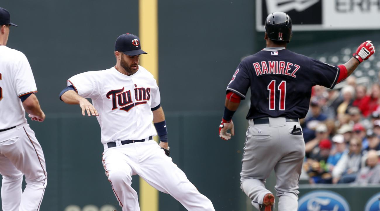Minnesota Twins first baseman Joe Mauer touches first as Cleveland Indians' Jose Ramirez grounds out in the third inning of a baseball game, Sunday, April 19, 2015, in Minneapolis. (AP Photo/Jim Mone)