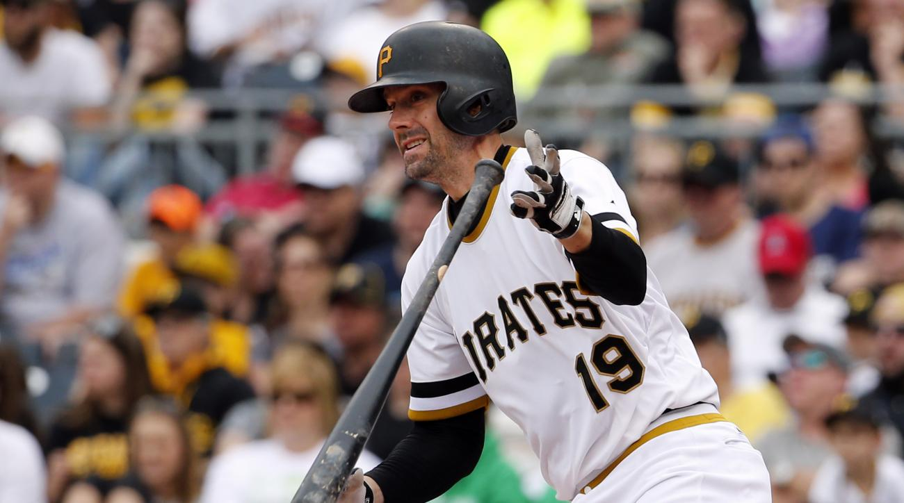 Pittsburgh Pirates' Chris Stewart (19) drives in two runs with a single off Milwaukee Brewers starting pitcher Matt Garza in the sixth inning of a baseball game in Pittsburgh, Sunday, April 19, 2015. (AP Photo/Gene J. Puskar)