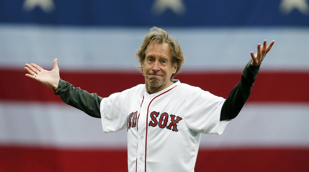 Veteran marathon runner Bill Rodgers gestures after throwing out the ceremonial first pitch before a baseball game between the Boston Red Sox and the Baltimore Orioles in Boston, Monday, April 20, 2015. (AP Photo/Michael Dwyer)