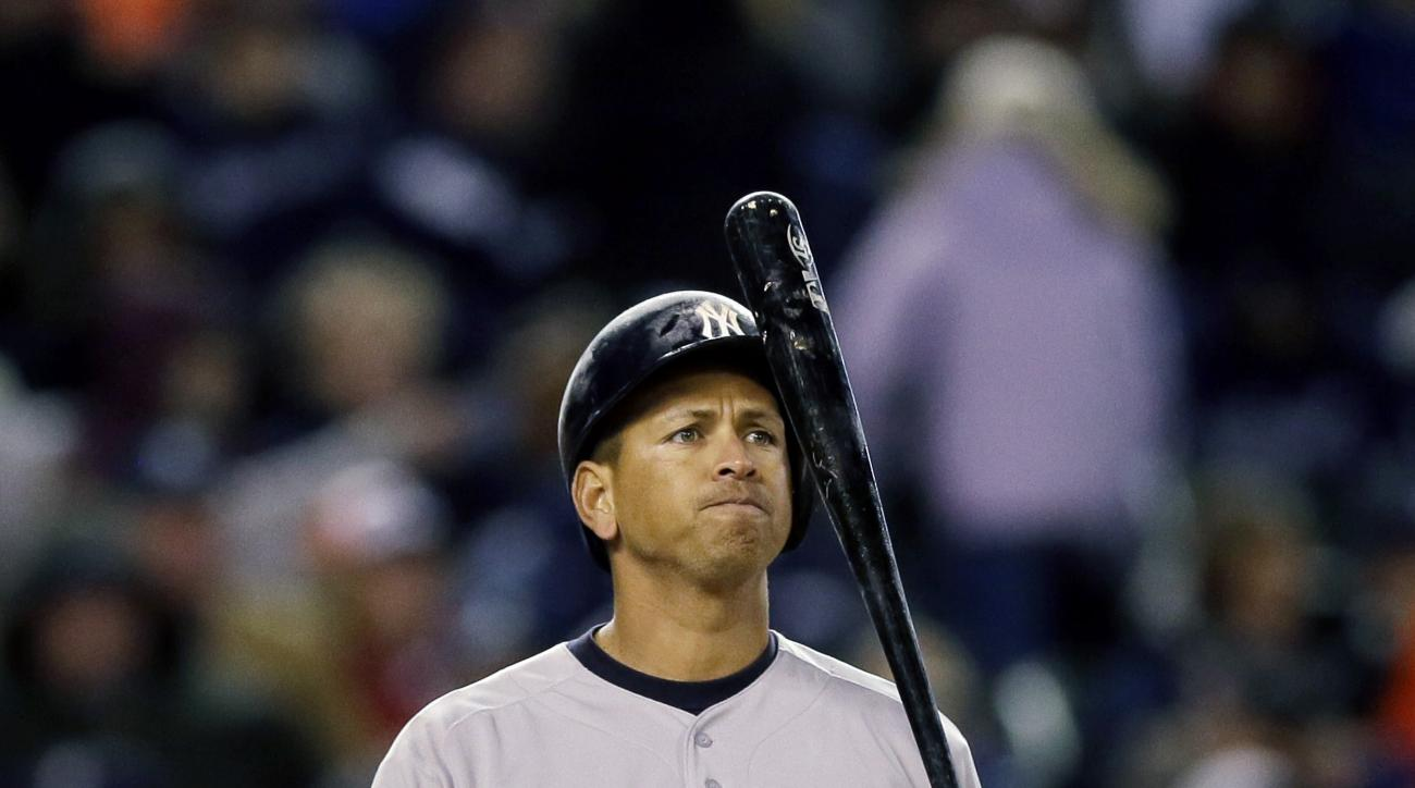 New York Yankees designated hitter Alex Rodriguez flips his bat during the sixth inning of a baseball game against the Detroit Tigers, Monday, April 20, 2015, in Detroit. (AP Photo/Carlos Osorio)