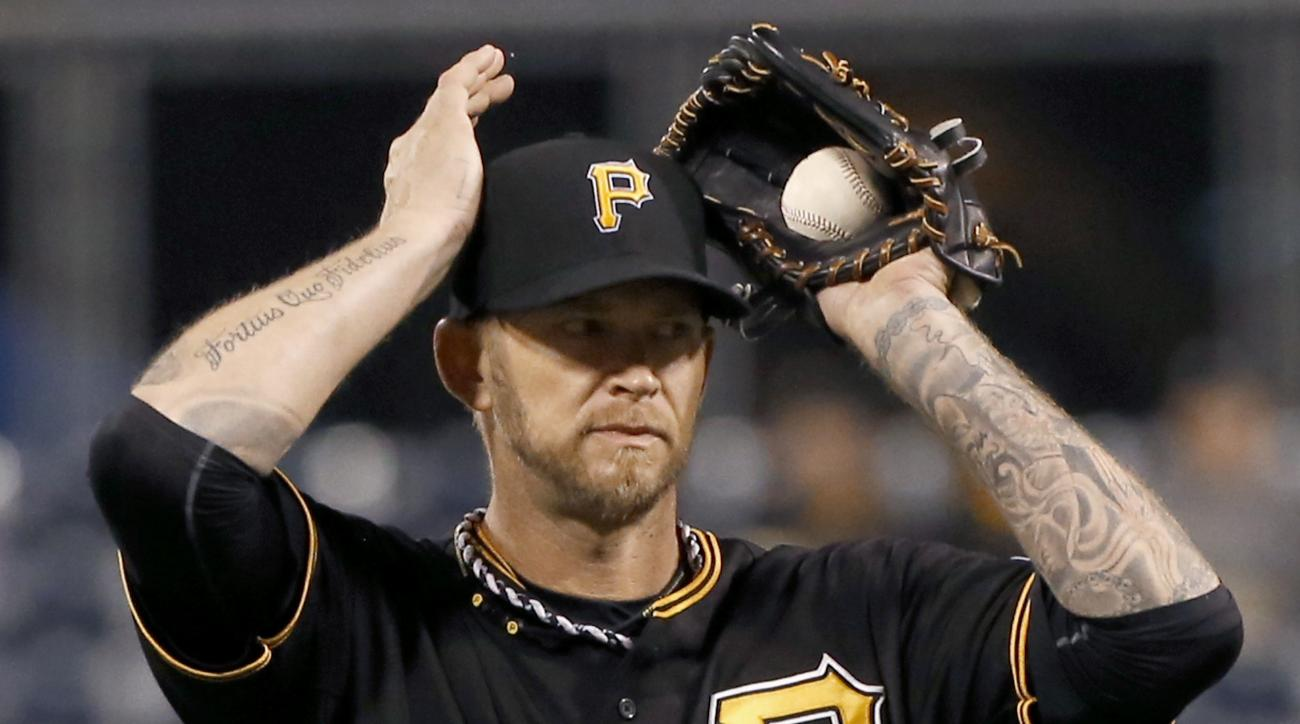 Pittsburgh Pirates starting pitcher A.J. Burnett adjusts his cap after giving up a base hit to Chicago Cubs' Jorge Soler in the fifth inning of a baseball game on Monday, April 20, 2015, in Pittsburgh. Soler came around to score on a hit by Kris Bryant. (