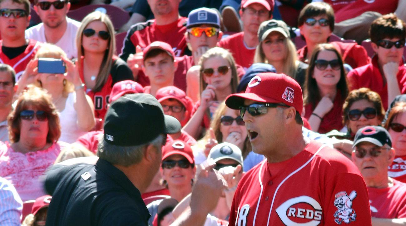 FILE - In this Sunday, April 12, 2015, file photo, Cincinnati Reds manager Bryan Price is ejected by umpire Joe West while arguing a call against the St. Louis Cardinals in the seventh inning of a baseball game, in Cincinnati. Price went on a profanity-fi
