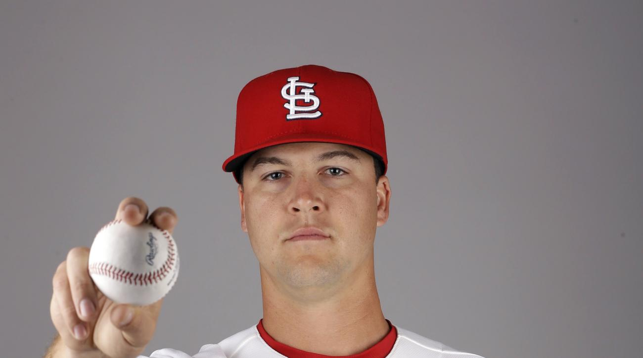 FILE - This is a 2015, file photo, Mitch Harris of the St. Louis Cardinals baseball team poses for a photo at spring training baseball in Jupiter, Fla. Pitcher Mitch Harris, a 29-year-old graduate of the U.S. Naval Academy, is in the major leagues for the