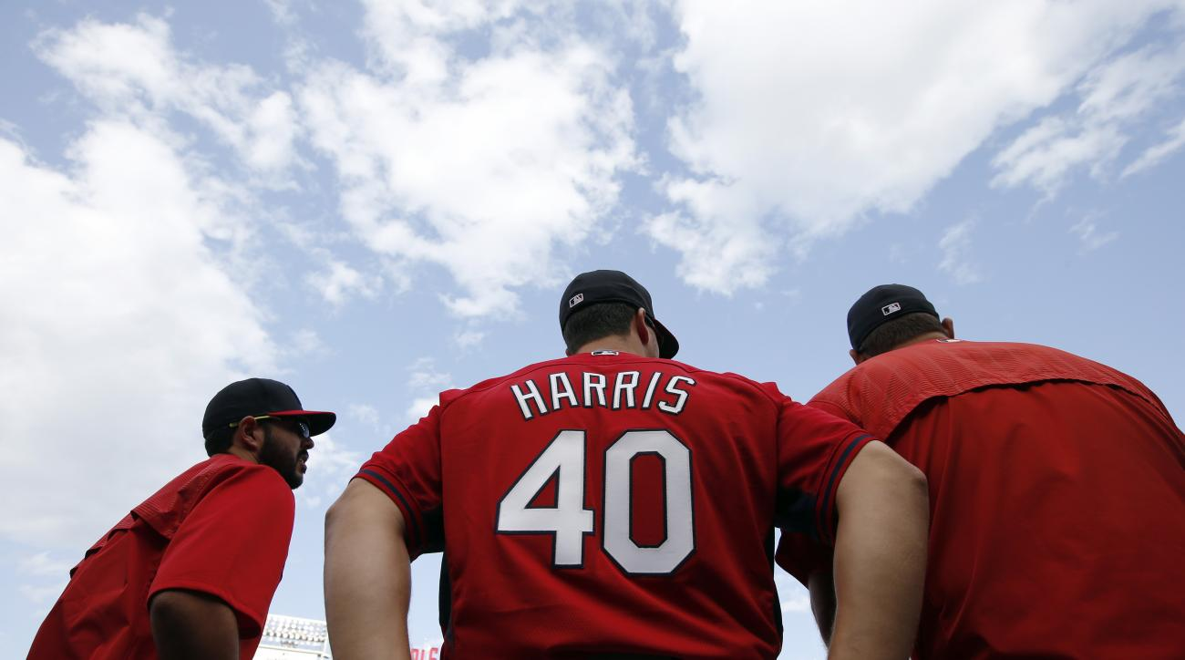 St. Louis Cardinals pitcher Mitch Harris, a 29-year-old graduate of the U.S. Naval Academy, pauses during batting practice before a baseball game against the Washington Nationals at Nationals Park, Tuesday, April 21, 2015, in Washington. Harris was called