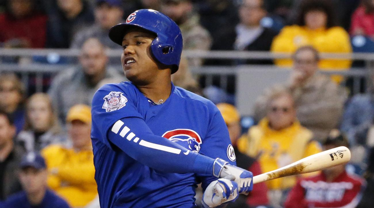 Chicago Cubs' Starlin Castro drives in a run with a single off Pittsburgh Pirates starting pitcher Francisco Liriano during the third inning of a baseball game in Pittsburgh, Tuesday, April 21, 2015. (AP Photo/Gene J. Puskar)