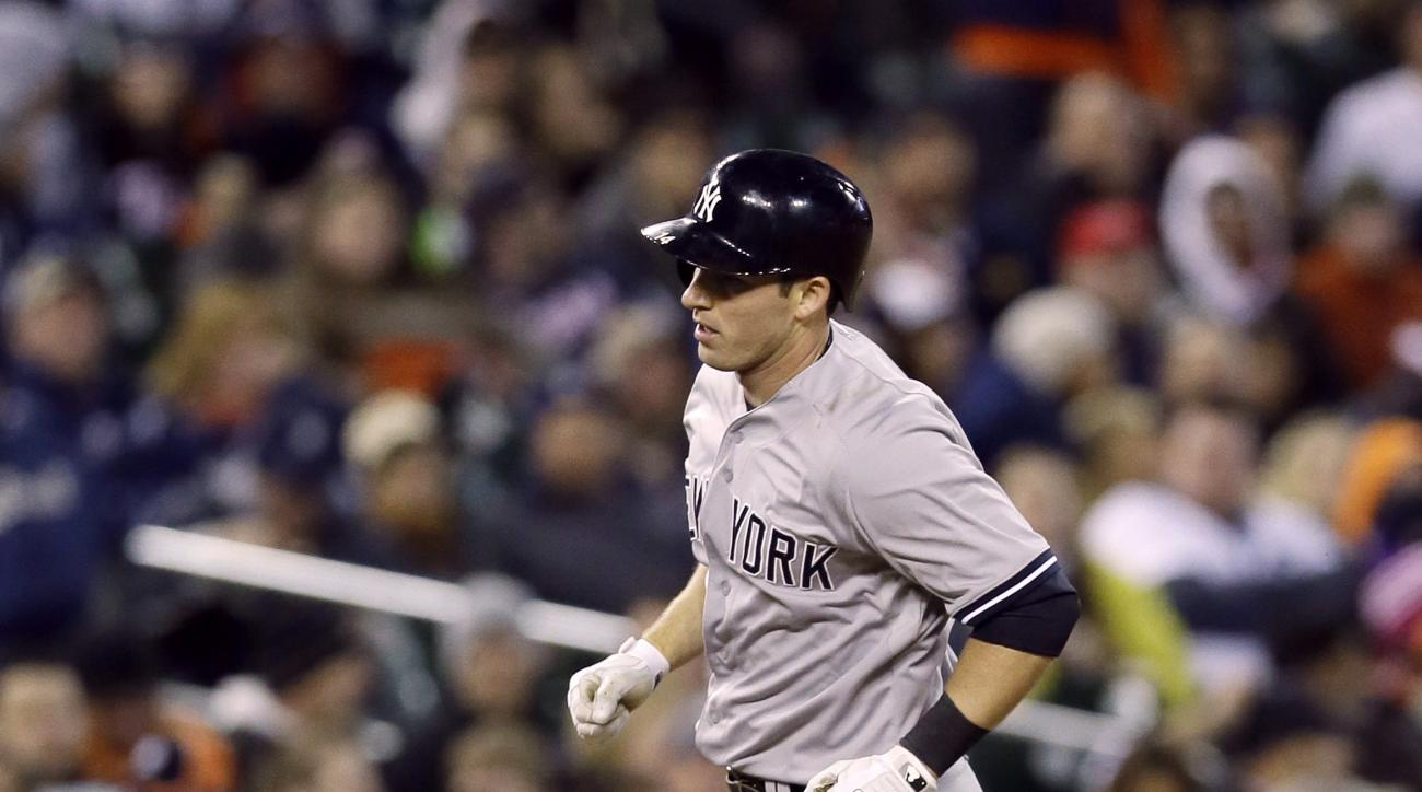 New York Yankees' Stephen Drew rounds third base after his home run during the seventh inning of a baseball game against the Detroit Tigers, Tuesday, April 21, 2015, in Detroit. (AP Photo/Carlos Osorio)