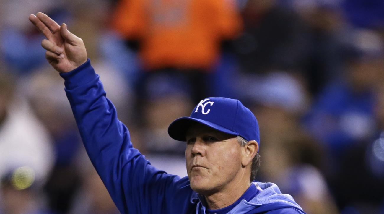 Kansas City Royals manager Ned Yost calls for a new pitcher during the sixth inning of a baseball game against the Minnesota Twins at Kauffman Stadium in Kansas City, Mo., Tuesday, April 21, 2015. (AP Photo/Orlin Wagner)