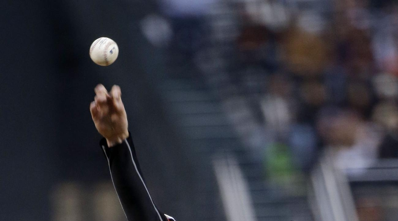 San Francisco Giants starting pitcher Tim Lincecum throws to the Los Angeles Dodgers during the first inning of a baseball game on Tuesday, April 21, 2015, in San Francisco. (AP Photo/Marcio Jose Sanchez)
