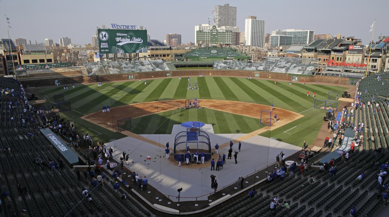 FILE - In this April 5, 2015, file photo, fans begin to fill the stands at Wrigley Field before the season-opening baseball game between the Chicago Cubs and the St. Louis Cardinals in Chicago. Ballparks are being designed with a greater emphasis on blend