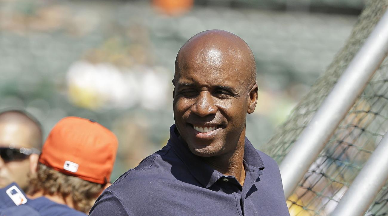 File - In this Sept. 6, 2014, file photo, career home run leader Barry Bonds gives a thumbs up while standing behind the batting cage and watching the Houston Astros take batting practice before the start of a baseball game against the Oakland Athletics i