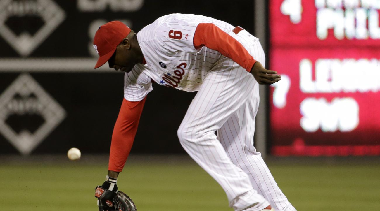 Philadelphia Phillies first baseman Ryan Howard cannot reach a single by Miami Marlins' Jacob Realmuto during the fourth inning of a baseball game, Wednesday, April 22, 2015, in Philadelphia. (AP Photo/Matt Slocum)