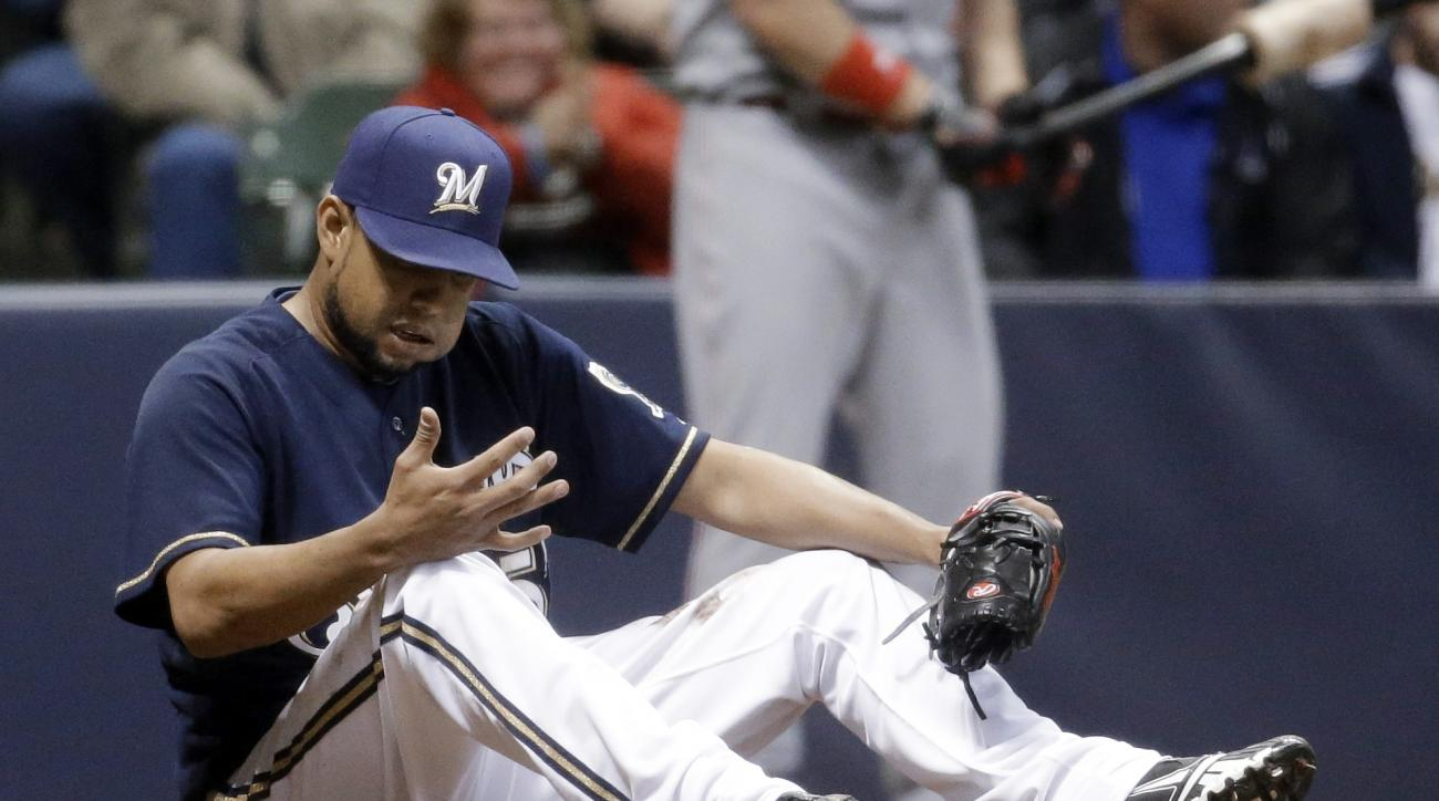 Milwaukee Brewers relief pitcher Francisco Rodriguez looks down at his hand after Cincinnati Reds' Billy Hamilton scored from third on a wild pitch during the ninth inning of a baseball game Wednesday, April 22, 2015, in Milwaukee. (AP Photo/Morry Gash)