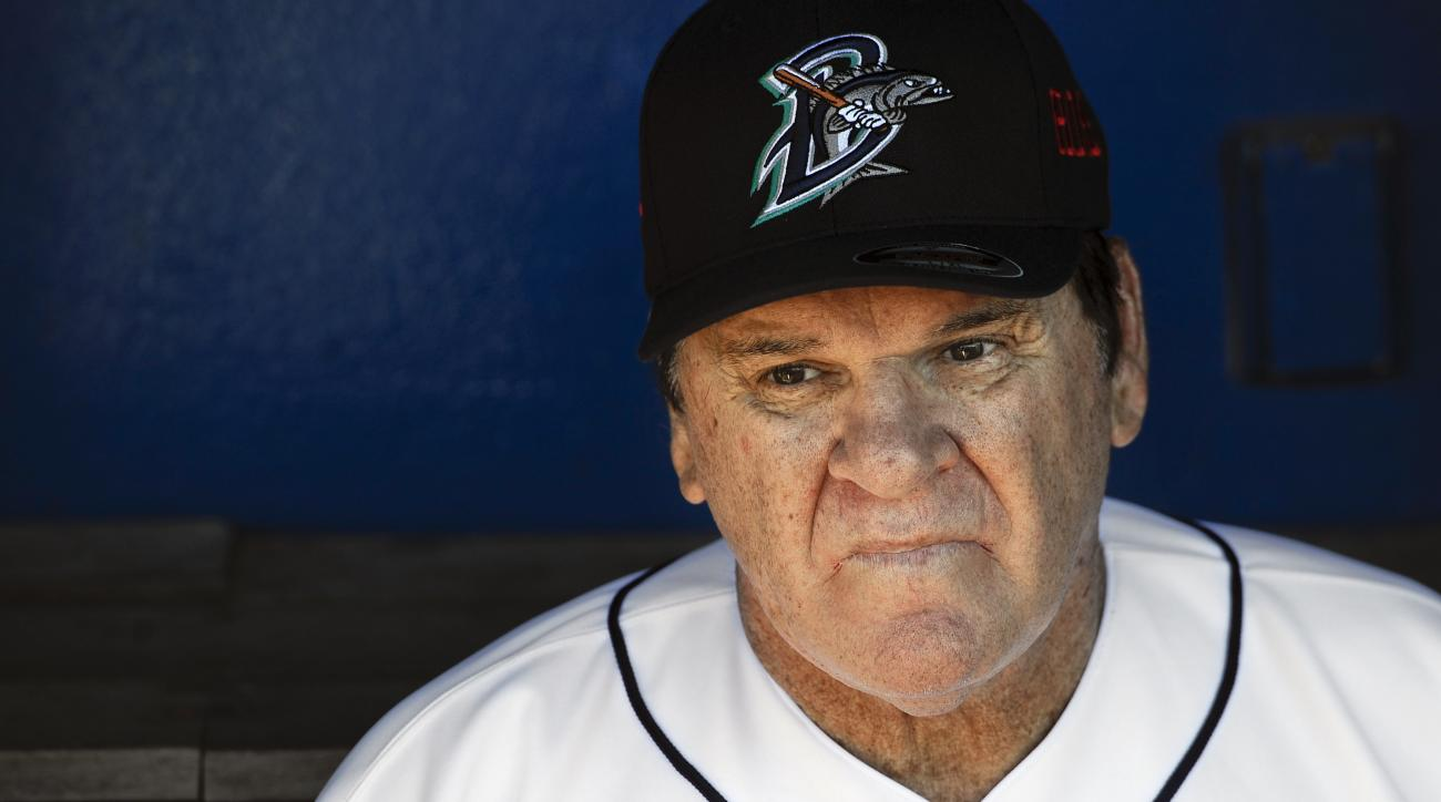 Pete Rose sits in the dugout at The Ballpark at Harbor Yard, Monday, June 16, 2014, in Bridgeport, Conn. Rose, banned from Major League Baseball, returned to the dugout for one day to manage the independent minor-league Bridgeport Bluefish. (AP Photo/Jess
