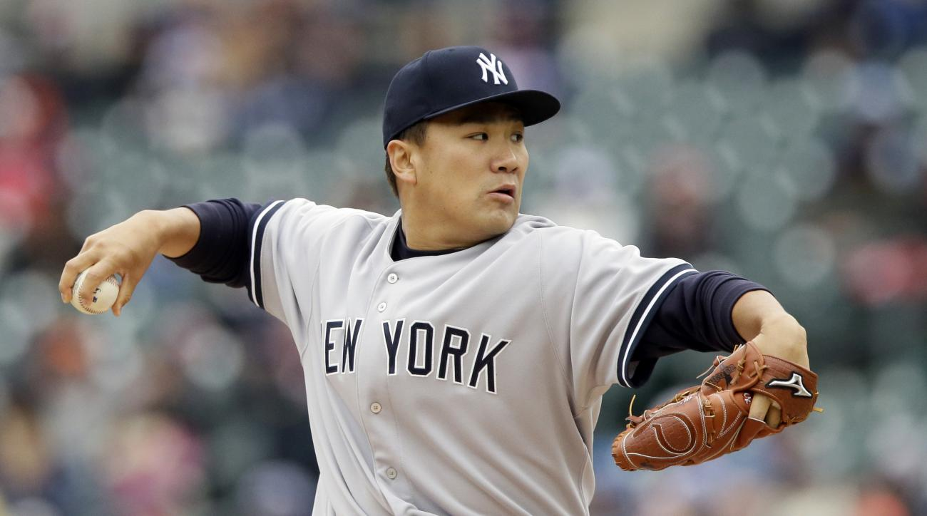 New York Yankees starting pitcher Masahiro Tanaka throws during the first inning of a baseball game against the Detroit Tigers, Thursday, April 23, 2015, in Detroit. (AP Photo/Carlos Osorio)